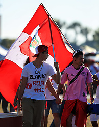 March 23, 2018 - Miami Gardens, Florida, USA - Peruvian fans walk with their flag outside of the stadium before the FIFA 2018 World Cup preparation match between the Peru National Soccer Team and the Croatia National Soccer Team at the Hard Rock Stadium in Miami Gardens, Florida. (Credit Image: © Mario Houben via ZUMA Wire)