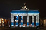 The Israeli national flag is projected on the Brandenburg Gate in solidarity with the victims of recent terror attack in Jerusalem. <br /> 4 IDF soldiers were killed and several others wounded as a Palestinian man rammed his truck through a group of Israeli soldiers on January 08, 2017.