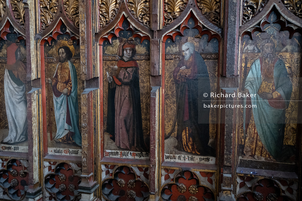 A detail of the medieval rood screen in the Church of St. Michael's, Aylsham which survived Puritan reformers, on 10th August 2020, in Aylsham, Norfolk, England. The rood screen was freshly gilded and painted in the early 16th Century but badly damaged by puritan reformers although sixteen painted figures can still be seen. The Church of St Michael and all Angels, Aylsham, Norfolk is a church of medieval origins that was built in the 14th century under the patronage of John of Gaunt, lord of the manor of Aylsham.
