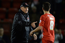 Leyton Orient Manager, Russell Slade shakes hands with Leyton Orient's Lloyd James after he scored the winning penalty - Photo mandatory by-line: Mitchell Gunn/JMP - Tel: Mobile: 07966 386802 08/10/2013 - SPORT - FOOTBALL - Brisbane Road - Leyton - Leyton Orient V Coventry City - Johnstone Paint Trophy