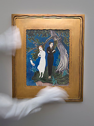 © Licensed to London News Pictures. 16/11/2012. London, UK. A Sotheby's employee adjusts 'Young Man in Black, Girl in White' (1919) (est. GB£400,000-600,000), a painting by Swedish artist Nils Dardel, at a press call taking place at the London based auction house's New Bond Street premises today (16/11/12).  The sale, featuring works by 19th century European painters, is set to take place on the 20th of November. Photo credit: Matt Cetti-Roberts/LNP