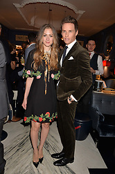 LONDON, ENGLAND 8 DECEMBER 2016: Eddie Redmayne, Hannah Redmayne at the Omega Constellation Globemaster Dinner at Marcus, The Berkeley Hotel, Wilton Place, London England. 8 December 2016.