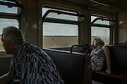 Luhansk, Ukraine - August 13, 2014: Passengers are seen during a train trip from the small village of Alchevsk towards Luhansk.  CREDIT: Photo by Mauricio Lima for The New York Times