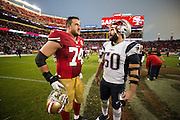 San Francisco 49ers tackle Joe Staley (74) and New England Patriots outside linebacker Rob Ninkovich (50) talk during the post-game scrum at Levi's Stadium in Santa Clara, Calif., on November 20, 2016. (Stan Olszewski/Special to S.F. Examiner)