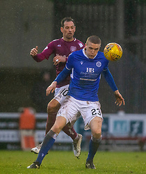 Arbroath's Gavin Swankie and Queen of the South's Iain Wilson. Arbroath 2 v 0 Queen of the South, Scottish Championship game played 15/2/2020 at Arbroath's home ground, Gayfield Park.