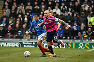Queens Park Rangers Defender, Toni Leistner (37) and Portsmouth Midfielder, Louis Dennis (18) during the The FA Cup fourth round match between Portsmouth and Queens Park Rangers at Fratton Park, Portsmouth, England on 26 January 2019.