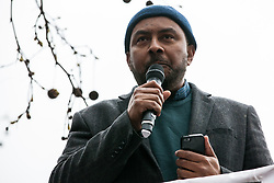 London, UK. 16th March, 2019. Dilwar Khan, Director of the East London Mosque, addresses thousands of people on the March Against Racism demonstration on UN Anti-Racism Day against a background of increasing far-right activism around the world and a terror attack yesterday on two mosques in New Zealand by a far-right extremist which left 49 people dead and another 48 injured.