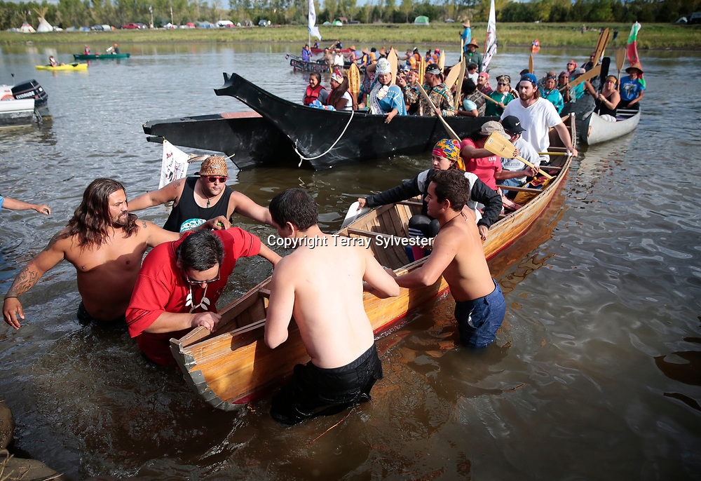 Paddlers from the Pacific Northwest and elsewhere arrive by canoe at the opposition camp against the Dakota Access oil pipeline on the banks of the Cannonball River on September 8, 2016. Cannon Ball, North Dakota, United States.