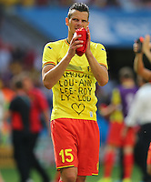 Daniel van Buyten of Belgium applauds at the end of the match in which Belgium got knocked out of the FIFA World Cup