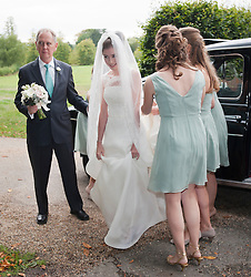 © London News Pictures. 14/09/2013.  The bride Suzanne Ashman arraigning at the church in a black cab, surrounded by bridesmaids and her father Jonathan Ashman (left). The wedding of Euan Blair, Son of former British Prime Minister Tony Blair,  to Suzanne Ashman at All Saints Parish Church in Wotton Underwood, Buckinghamshire. The wedding was attended by Former British Prime minister Tony Blair and his wife Cherie Blair. Photo credit: Ben Cawthra/LNP