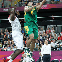 31 July 2012: Brazil Alex Garcia goes for the layup past Luol Deng during 67-62 Team Brazil victory over Team Great Britain, during the men's basketball preliminary, at the Basketball Arena, in London, Great Britain.
