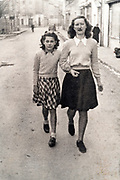 mother with daughter or sisters walking ca early 1960s France