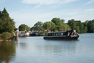 Narrowboat on the River Thames at Godstow Lock, River Thames, Oxford, Uk
