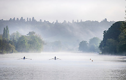 © Licensed to London News Pictures. 24/05/2021. Henley-On-Thames, UK. Rowers make their way through a mist covered landscape in the early morning on the River Thames at Henley-on-Thames in Oxfordshire . Photo credit: Ben Cawthra/LNP