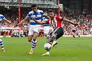 Brentford Forward Ollie Watkins (11) has a shot on goal during the EFL Sky Bet Championship match between Brentford and Queens Park Rangers at Griffin Park, London, England on 21 April 2018. Picture by Andy Walter.