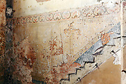 wall with carved graffiti and removed stairs