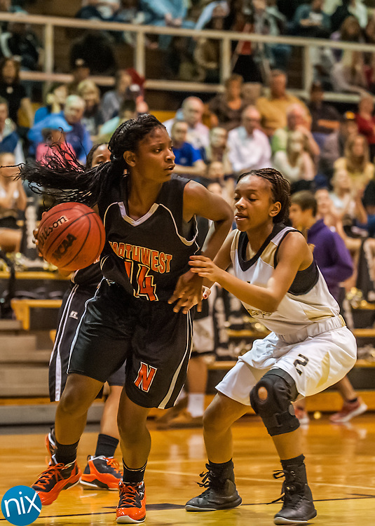Northwest Cabarrus' Vanda McNeil gets past Concord's Danica Ford Tuesday night at Concord High School. The Trojans won the game 52-43.