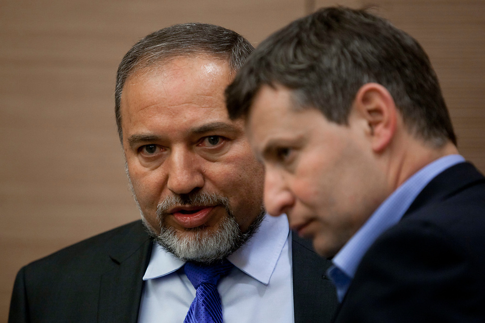 Israel's Foreign Minister Avigdor Lieberman (L) and Israel's Tourism Minister Stas Misezhnikov attend an Yisrael Beiteinu faction meeting at the Knesset, Israel's parliament in Jerusalem, on January 30, 2012.
