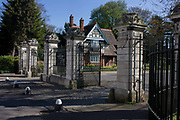 The main entrance/exit pillars and gates to Dulwich Park with College Lodge, in the south London borough of Southwark. Old College Gate is on College Rd, one of four main gates into the park. Dulwich Park is a 30.85-hectare park in the London Borough of Southwark, south London, England, opened in 1890 by Lord Rosebery, initially designed by Charles Barry (junior), later refined by Lt Col J. J. Sexby (who also designed Battersea, Ruskin and parts of Southwark Parks). In 2004–6, the park was restored to its original Victorian layout, following a grant from the Heritage Lottery Fund.