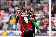 Lewis Grabban and Tokelo Rantie of AFC Bournemouth share a joke during the Skybet Championship match , AFC Bournemouth v Blackburn Rovers at The Goldsands Stadium in Bournemouth, England on Saturday 28th September 2013. Picture by Sophie Elbourn/Andrew Orchard Sports Photography.
