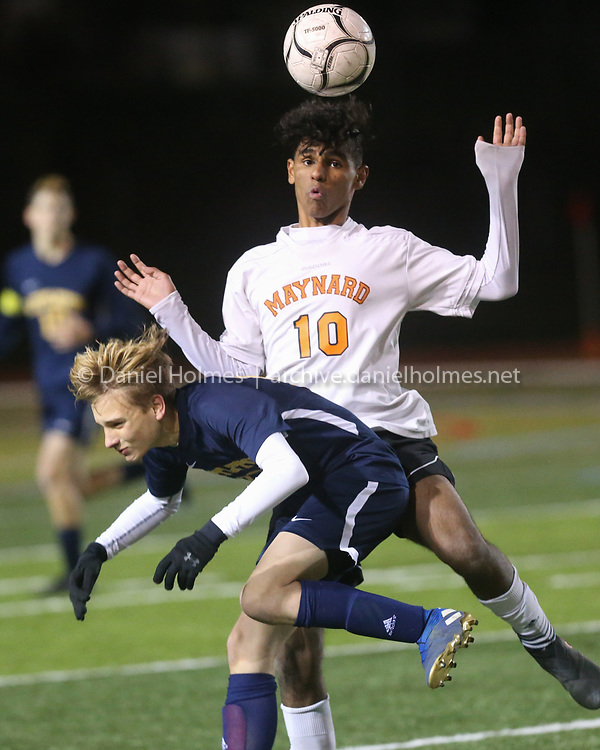 (11/11/19, WORCESTER, MA) Maynard's Diego Pinto and Littleton's Charles Martin fight for the ball during the Central Division 4 semifinal at Foley Stadium in Worcester on Monday. [Daily News and Wicked Local Photo/Dan Holmes]