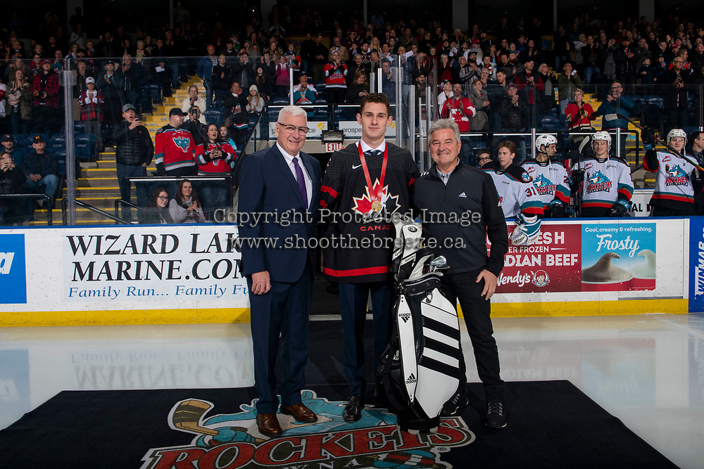 KELOWNA, BC - JANUARY 8:  Kelowna Rockets' president  and general manager, Bruce Hamilton and Greg Murtland of Adidas Canada present Nolan Foote with a new set of golf clubs for bringing home the gold medal from the IIHF World Junior Hockey Championships at Prospera Place on January 8, 2020 in Kelowna, Canada. (Photo by Marissa Baecker/Shoot the Breeze)