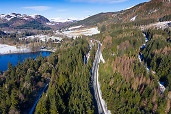Pitlochry, Perthshire, Scotland, UK. 11 Feb 2021. Aerial view of single carriageway section of the A9 at Pitlochry. The Scottish Government's latest Infrastructure Investment Plan (IIP) does not commit to finishing dialling the entire length of the A9 by 2025 as originally anticipated. Iain Masterton/Alamy Live news