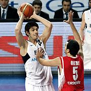 Efes Pilsen's Kerem GONLUM (L) during their Turkish Basketball league match Efes Pilsen between Erdemir at the Sinan Erdem  Arena in Istanbul Turkey on Saturday 29 January 2011. Photo by TURKPIX