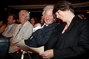Gold award winner the Isle of Eigg read their scroll  at the 2010 Ashden Awards ceremony at the Royal Geographic Society.