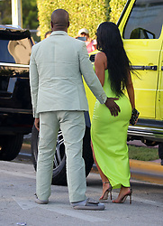 Kim Kardashian and Kanye West leave a wedding ceremony and stop for ice cream at Haagen Daaz before heading to the reception in Miami Beach, Florida. The couple showed plenty of PDA as Kanye insisted on lifting Kim out of the oversized Mercedes each time they stopped, placing a hand on her butt afterwards. 18 Aug 2018 Pictured: Kim Kardashian; Kanye West. Photo credit: MEGA TheMegaAgency.com +1 888 505 6342