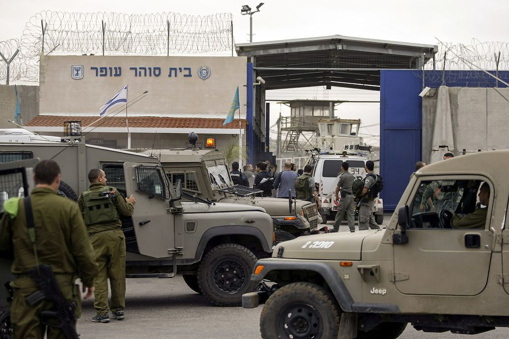 Israeli prison guards, police and soldiers prepare to enter Ofer Prison, during clashes with Palestinian inmates at Ofer prison, near the West Bank city of Ramallah, on December 20, 2008. According to Israeli officials, seven Palestinian inmates and three Israeli prison guards were injured in the clashes, which broke after Palestinian inmates refused and forcefully resisted a search by prison authorities to the tents in which the inmates sleep in.