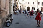 Street scene in the ancient town of Spello in Umbria, Italy. The densely inhabited town is a well known tourist destination, built of stone,and is of decidedly medieval aspect, and is enclosed in a circuit of medieval walls on Roman foundations.