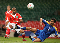 Photo: Rich Eaton.<br /> <br /> Wales v Cyprus. UEFA European Championships 2008 Qualifying. 11/10/2006. Robert Earnshaw of Wales left tries a shot as Cyprus defender Loukas Louka tries to block