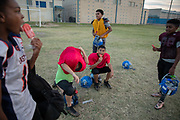 The Junior Mustangs celebrate a team member's birthday after practice at John Jay High School in San Antonio, Texas. The 10-12 year olds aim to defend a 2017 state championship in the Texas Youth Sports Association league.