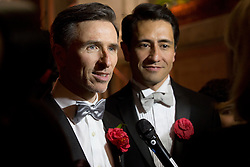© Licensed to London News Pictures . 28/03/2014. London, UK.  Newlyweds Peter McGraith, left, and David Cabreza become one of the first in the UK to marry under the new law tonight (29/03/14) at Islington Town Hall, east London. . Photo credit: Isabel Infantes /LNP