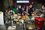 """Aladdin Charni cooking with volunteers in the kitchen.<br /><br />The Freegan Pony is an alternative restaurant housed in a squat. It was founded in 2015 by Aladdin Charni with three other collaborators. The restaurant specialises in cheap vegetarian cuisine, serving meals which guests reserve a place through a Facebook group, paying €2 a meal. The restaurant meals contain unsold and donated food, collected from wholesellers at the Paris Rungis vegetable market. The Freegan Pony is located at the Porte de la Vilette on the outskirts of Paris, at the entrance to the peripherique outer circle motorway.<br /><br />Freegans are people who employ alternative strategies for living based on limited participation in the conventional economy and minimal consumption of resources. Freeganism is the practice of reclaiming and eating food that has been discarded. People who attempt to live an ethical lifestyle by reusing trash and rubbish thrown away by others.<br /><br />Freeganism is an ill-defined activity and is a subset of the larger anti-capitalist and environmental protest movements. It embraces alternative, anti-consumerist lifestyles. Freegan practices also include co-operative living, squatting and """"freecyling"""", or matching things that people want to get rid of with things other people need"""