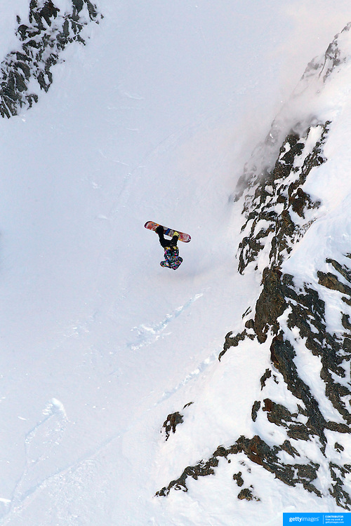 Freerider Jake Koia of New Zealand crashes off a launch during the World Heli Challenge Extreme Day at Mount Albert on Minaret Station, Wanaka, New Zealand. 1st August 2011