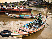 21 OCTOBER 2015 - YANGON, MYANMAR:   A boatman who operates a cross river ferry waits to take on passengers at Botataung Pier, near Botataung Paya on the riverfront in Yangon. PHOTO BY JACK KURTZ