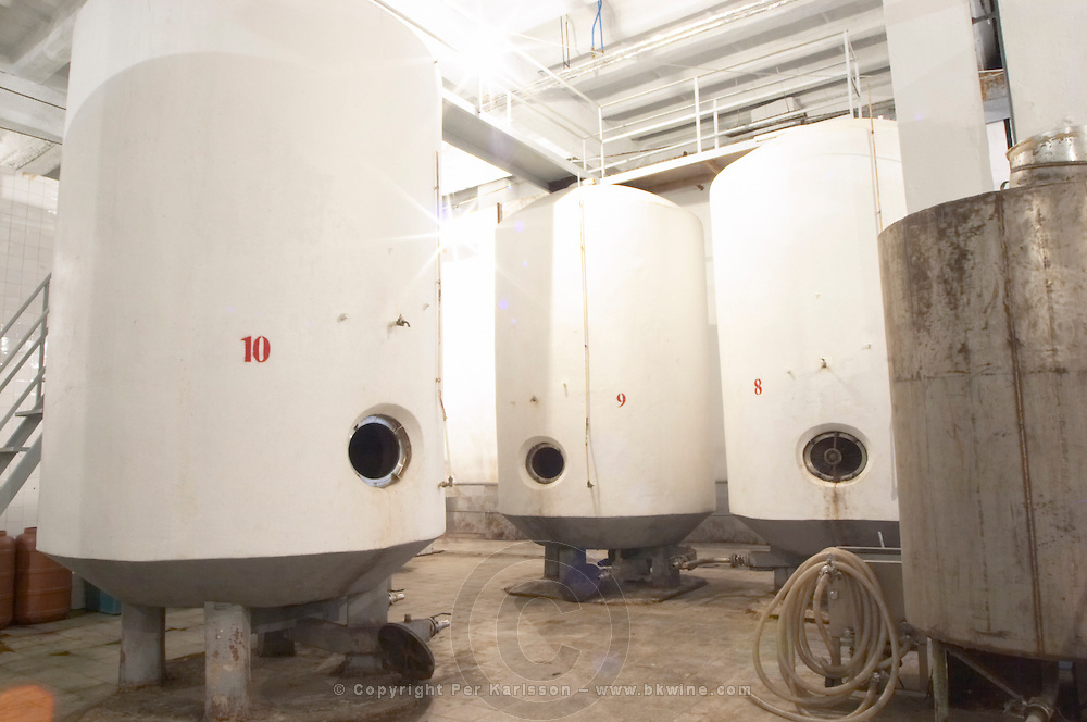 Circular concrete fermentation tanks painted in white and numbered 10 9 8. Kantina e Pijeve Gjergj Kastrioti Skenderbeu Skanderbeg winery, Durres. Albania, Balkan, Europe.