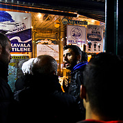 Refugees at a ferry ticket booth in Mytilene on Lesvos Island in Greece after arriving via Turkey before being ferried to mainland Europe. Some estimates say as many as 9,000 have been arriving from Turkey a day.