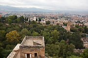 The Alhambra Palace and fortress complex located in Granada, Andalucia, Spain. The tallest section and military watchtower, The Alcazaba, looking out across to the south of the great city.