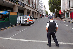 © Licensed to London News Pictures.  16/08/2012. LONDON, UK. Police guard the scene in Orchard Street (off Oxford Street) following a controlled explosion of a suspect package. Photo credit :  Cliff Hide/LNP