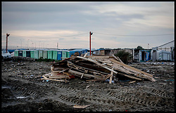 October 27, 2016 - Calais, Northern France, France - Image ¬©Licensed to i-Images Picture Agency. 27/10/2016. Calais, France. Calais Jungle Migrant Camp. the remains of the accommodation in the Calais Jungle migrant camp after bulldozers have torn it apart all day. As the French police close it down. Picture by Andrew Parsons / i-Images (Credit Image: © Andrew Parsons/i-Images via ZUMA Wire)