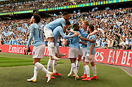 Goal - Raheem Sterling (7) of Manchester City celebrates after scores a goal to give a 5-0 lead with Kevin De Bruyne (17) of Manchester City and Bernardo Silva (20) of Manchester City during the The FA Cup Final match between Manchester City and Watford at Wembley Stadium, London, England on 18 May 2019.