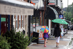 © Licensed to London News Pictures. 22/08/2013<br /> Wet weather today (22.08.2013)<br /> People with Umbrellas up and coats on for the wet weather today in  Pettswood, Kent.<br /> Photo credit :Grant Falvey/LNP