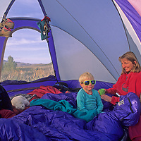 A mother and her sons wake up in a tent during a camping trip to California's eastern Sierra Nevada.