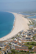 Chesil beach from Portland Bill, Dorset, England. Chesil Beach is a pebble beach 18 miles long and stretches north-west from Portland to West Bay. For much of its length it is separated from the mainland by an area of saline water called the Fleet Lagoon.