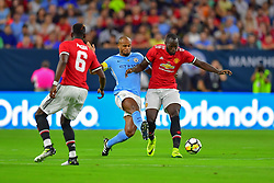 Manchester United forward Romelu Lukaku (9) and Manchester City defender Vincent Kompany (4) during play at the International Champions Cup match between Manchester United and Manchester City at NRG Stadium in Houston, Texas