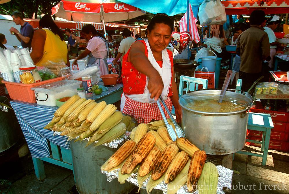 MEXICO, OAXACA, OAXACA STATE Zocalo or main square activity, vendor selling elote or roasted corn