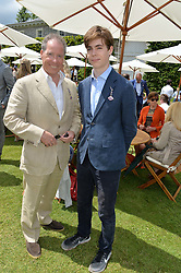 Left to right, VISCOUNT LINLEY and his son the HON.CHARLES ARMSTRONG-JONES at the Cartier hosted Style et Lux at The Goodwood Festival of Speed at Goodwood House, West Sussex on 26th June 2016.